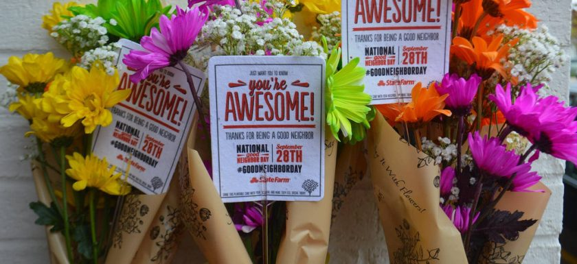 "alt=""three bouquets of yellow, green, pink, orange and white flowers wrapped in paper with cards on wire sticks saying You're awesome"""