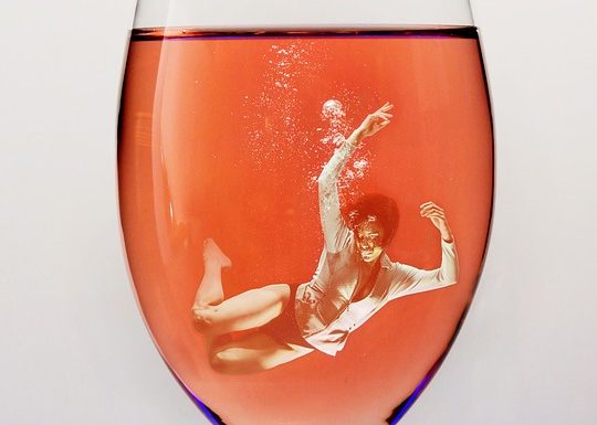 "alt=""woman drowning in glass of wine"""