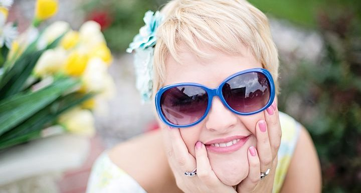 """alt=""""smiling face of middle-aged woman with sunglasses"""""""