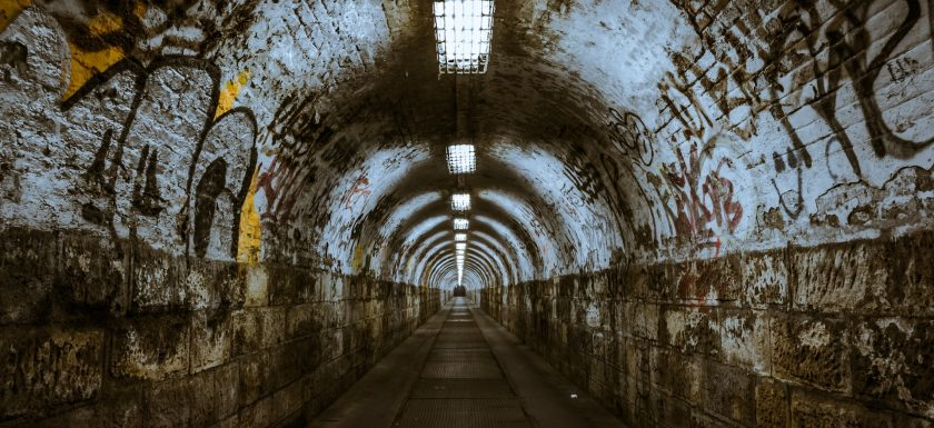 "alt=""tunnel with graffiti"""