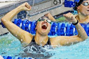 "alt=""female swimmer celebrating win"""